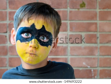 Boy with Painted Face Super Hero Style Stock photo ©