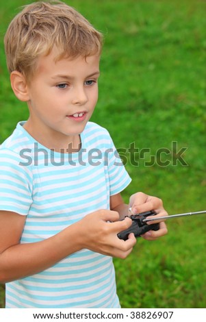 boy with panel for radio control in hands
