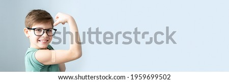 Boy with patch on hand, vaccinated against coronavirus infection. Vaccination against covid-19. Sputnik-V. banner, Copy space.