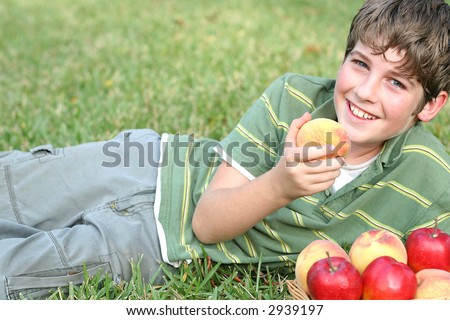 boy with peaches & apples - stock photo