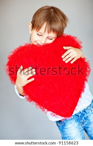Boy with red heart
