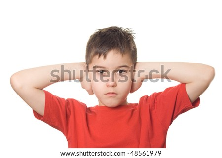 Boy with red T-shirt holding both hands on his ears to prevent him from hearing