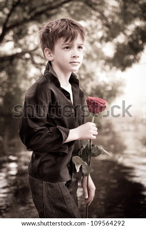 Boy with rose in his hand, aged photos, summer
