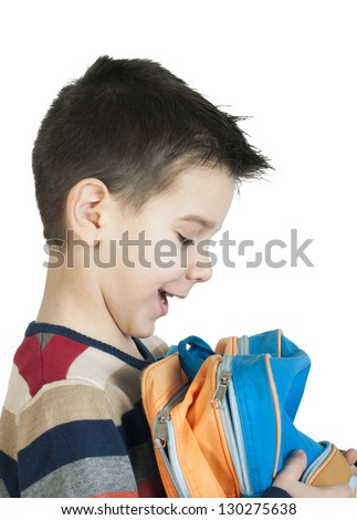 Boy with schoolbag. White isolated studio shot