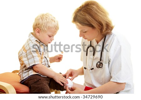 Boy with scratched knee at the podiatrist