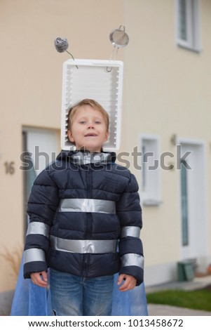 Stock Photo Boy with self constructed space hat