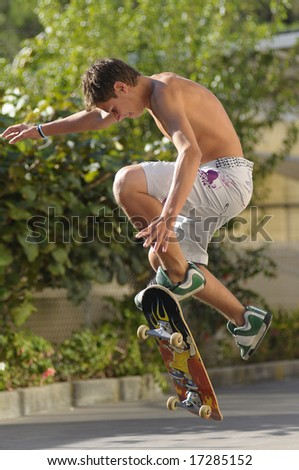 Boy with skateboard jumping in the air