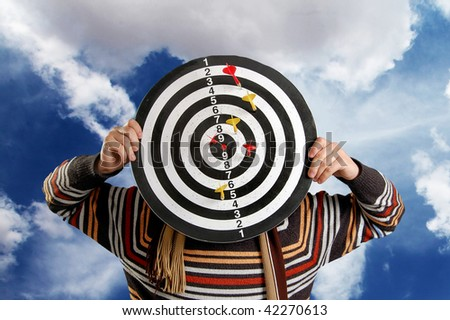 Boy with target at cloud background