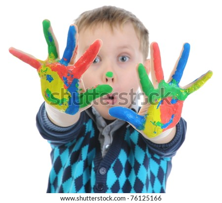 boy with the palms painted by a paint. Isolated on white background