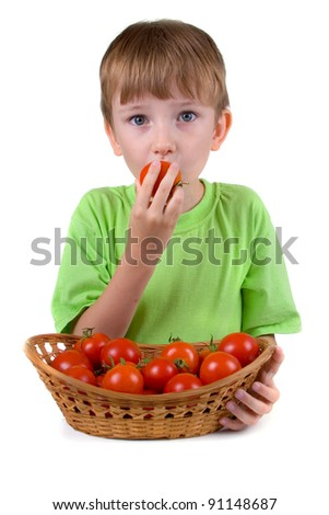Boy with tomatoes isolated on a white background