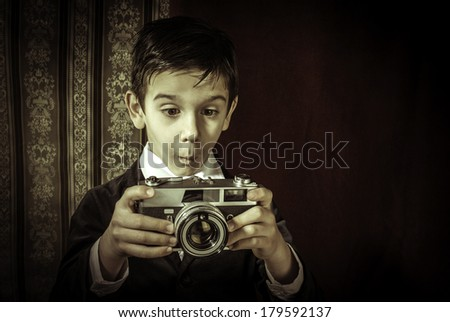 Boy with vintage camera. Vintage clothes