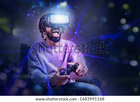 Boy with VR glasses play with a virtual videogame