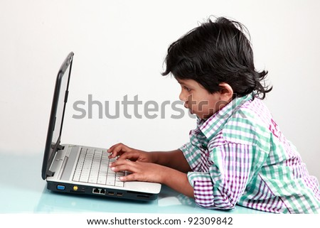 Boy works with a laptop