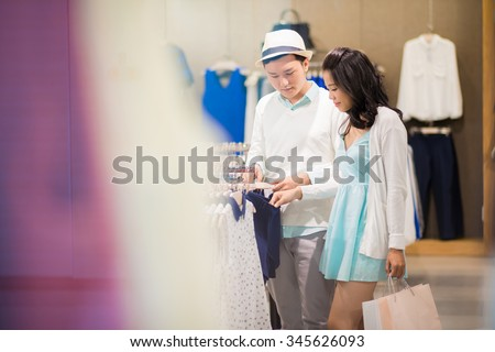 Boyfriend and girlfriend choosing clothes together #345626093
