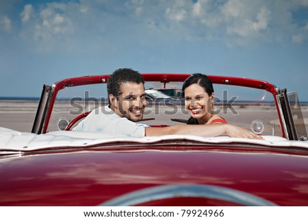 boyfriend and girlfriend sitting in vintage car and hugging in havana, cuba. Horizontal shape, side view, copy space