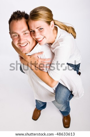 Boyfriend giving girlfriend piggy back ride