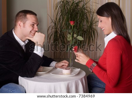 boyfriend is giving an engagement ring to his girlfriend on st Valentines Day - stock photo