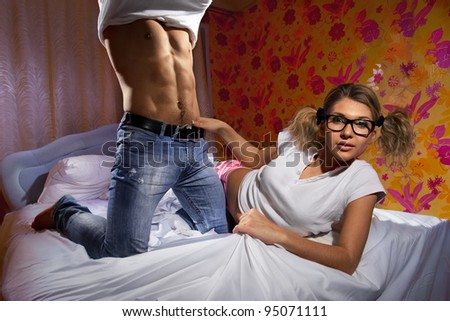 Boyfriend undressing on bed to his sweetheart at home