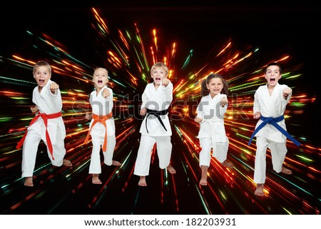 Boys and girls are beating blows arms on black background with colored flares