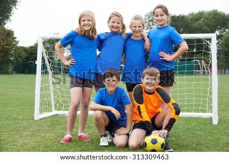 Boys And Girls In Elementary School Soccer Team