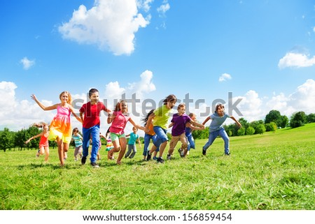 Boys and girls in large group running in the park on sunny summer day in casual clothes #156859454