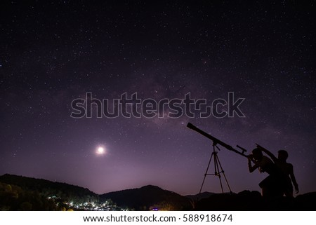 Boys and girls telescopic. Milky Way galaxy, on the mountains. Long exposure photograph, with grain.Image contain certain grain or noise and soft focus. #588918674