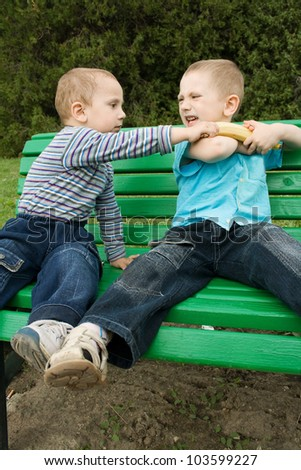 boys are fighting because of the banana