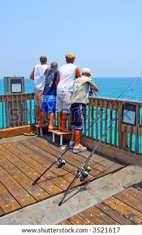 Boys Fishing From Pier