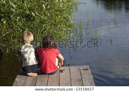 boys fishing nearby river