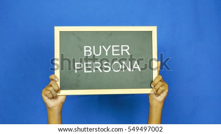 Shutterstock boys hand holding a blackboard with the words