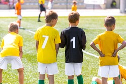Boys in Yellow Soccer Jerseys with Player Numbers on Back. Football Team Standing on Sideline. Group of Young Boys in School Sports Team. Kids Soccer Substitute Players