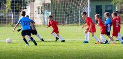 boys kicking football on the sports field