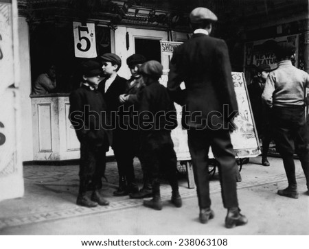 Boys of all ages going to the movies and defying state school laws, 2:30 pm, Jersey City, New Jersey, photograph by Lewis Wickes Hine, November, 1912.