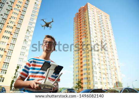 BOYS OF TEENAGERS DRIVES THE REMOTE BY AN UNMANNED DRON