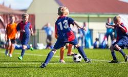 Boys Play Football; Children kicking Soccer Ball; Football Tournament for Youth Sports Teams