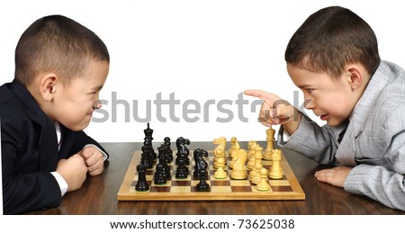 boys playing chess game, one is upset over a move by the other
