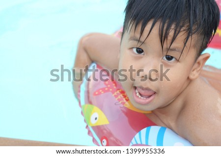 5c73d81fa274b Portrait of little African American girl smiling in pool Images and ...