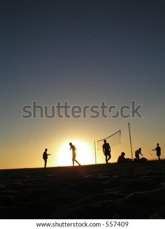 Boys playing volley ball