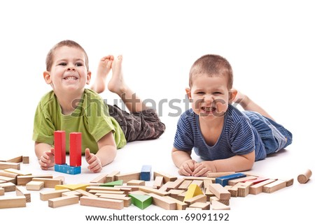 Boys playing whit blocks isolated on white and showing mouth and teeth