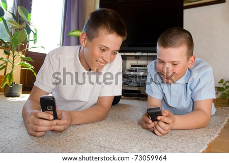 Boys playing with cell phones