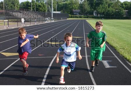 Boys Running on Race Track