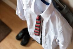 Boys school uniform on hanger