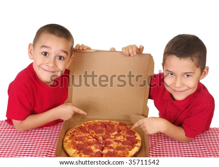 Boys six and seven years old ready to eat a take-out pepperoni pizza