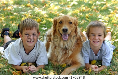 Boys with dog - stock photo