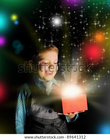 Boyt smiles and holding a gift in magic packing