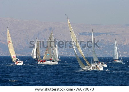 BOZCAADA, TURKEY - JULY 10: Bozcaada-Cesme Navy Cup in Aegean Sea. Race is starting. Turkey, July 10, 2006.