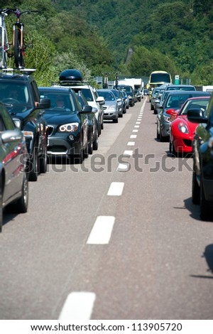 BOZEN, ITALY - JULY 31: Traffic jam driving back to the south on July 31, 2012 in Bozen, Italy. The A22 freeway in summertime from north to south register more than 200,000 vehicles a day.