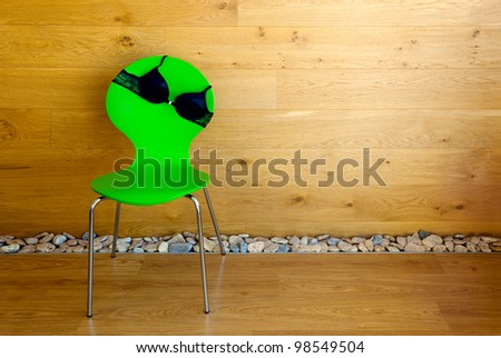 Bra on the chair / wooden wall / modern interior