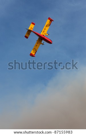 BRAC, CROATIA - JULY 15: Canader fighting wildfire on July 15, 2011 in Brac, Croatia. The fire burnt a third of the island's forest and agricultural area.