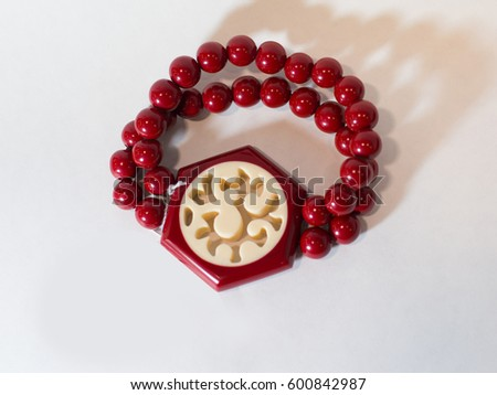 Bracelet red hand on a white background ethnic #600842987